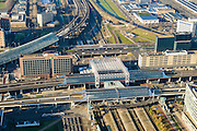 Nederland, Noord-Holland, Amsterdam, 11-12-2013; Station Sloterdijk - Telepoort en omgeving. Hemboog (met overkapping) buigt af richting Zaandam, station Sloterdijk aan het Orlyplein.<br /> Railwaystation AMsterdam West with conncecting arches. luchtfoto (toeslag op standard tarieven);<br /> aerial photo (additional fee required);<br /> copyright foto/photo Siebe Swart