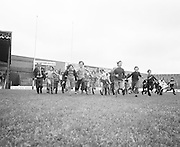 Children running down the pitch during their visit to Croke Park during a Kells Educational Tour on the 12th of June 1975.