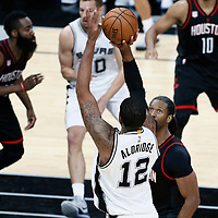 03 May 2017: San Antonio Spurs forward LaMarcus Aldridge (12) takes a jump shot over Houston Rockets center Nene Hilario (42) during the San Antonio Spurs 121-96 victory over the Houston Rockets, in game 2 of the Western Conference Semi Finals, at the AT&T Center, San Antonio, Texas, USA.