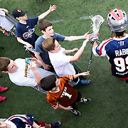 Paul Rabil #99 of the Boston Cannons runs onto the field prior to the game at Harvard Stadium on May 10, 2014 in Boston, Massachusetts. (Photo by Elan Kawesch)