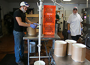 Corey Youngs, left, and Drew Pfendler work on a batch of Riesling ice cream at Mercer's Dairy in Boonville, New York, USA, on Friday, July 25, 2014. Mercer's is the only producer of wine ice cream, and manufactures all of its products in Boonville for distribution throughout the world. Photographer: Mike Bradley/Bloomberg