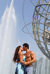 romantic couple by an outdoor fountain in New York