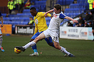 Tranmere Rovers' Matthew Pennington tackles Coventry City's Franck Moussa. Skybet football league 1match, Tranmere Rovers v Coventry city at Prenton Park in Birkenhead, England on Saturday 22nd Feb 2014.<br /> pic by Chris Stading, Andrew Orchard sports photography.