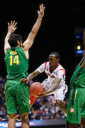 INDIANAPOLIS, IN - MARCH 29: Russ Smith #2 of the Louisville Cardinals passes around Arsalan Kazemi #14 of the Oregon Ducks during the regional round of the 2013 NCAA Men's Basketball Tournament at Lucas Oil Stadium on March 29, 2013 in Indianapolis, Indiana. (Photo by Joe Robbins)