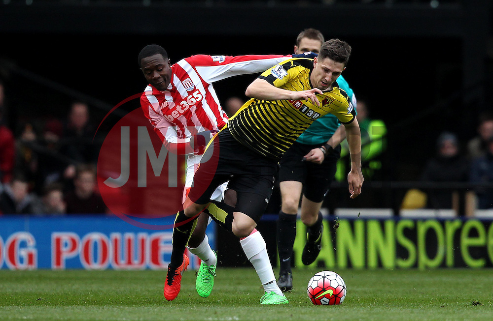 Giannelli Imbula of Stoke City fouls Craig Cathcart of Watford - Mandatory byline: Robbie Stephenson/JMP - 19/03/2016 - FOOTBALL - Vicarage Road - Watford, England - Crystal Palace v Leicester City - Barclays Premier League