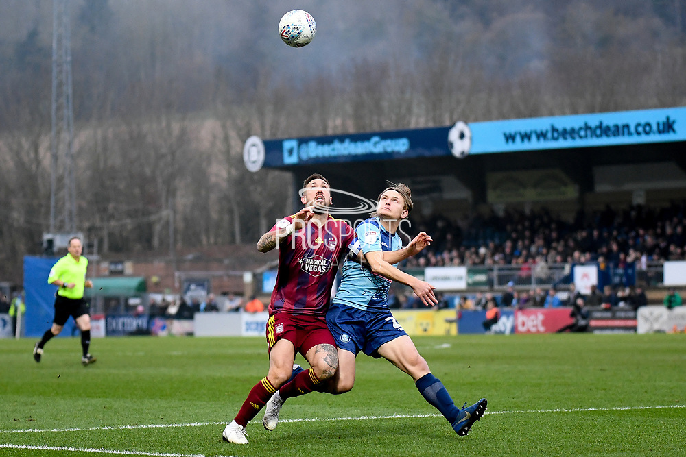 Ipswich Town defender Luke Chambers (4) battles for possession  with Wycombe Wanderers striker Alex Samuel (25) during the EFL Sky Bet League 1 match between Wycombe Wanderers and Ipswich Town at Adams Park, High Wycombe, England on 1 January 2020.