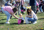 FAIRLESS HILLS, PA - APRIL 12:  A young girls finds and Easter egg with some help from family during the YMCA Easter Egg Hunt April 12, 2014 in Fairless Hills Pennsylvania. (Photo by William Thomas Cain/Cain Images)