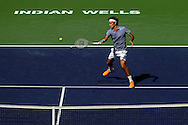 Indian Wells, CA - Roger Federer of Switzerland in action during the final match against Novak Djokovic of Serbia on stadium court at the BNP Paribas Open.