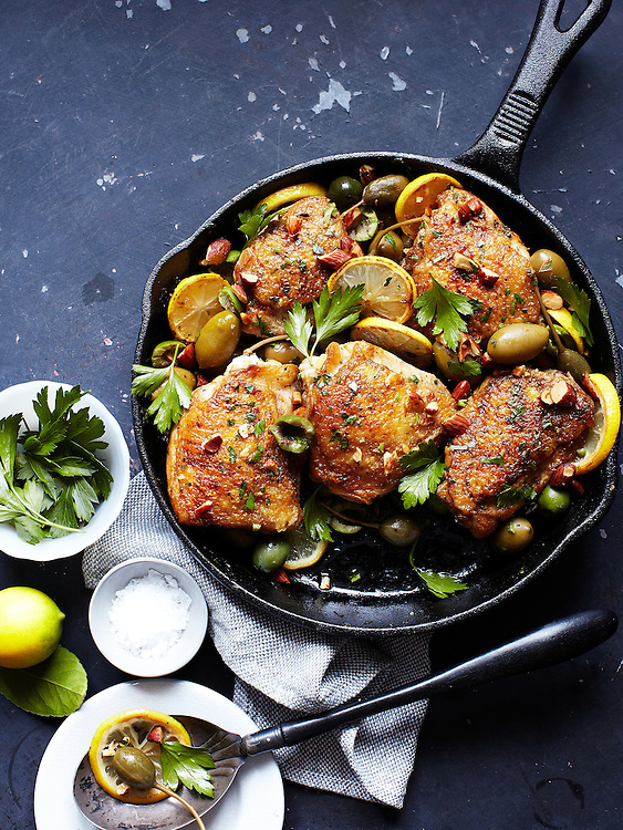 Skillet Suppers: Baked Chicken Thighs with Green Olives, Caper Berries, and Lemon Slices