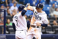 May 9, 2017 - St. Petersburg, Florida, U.S. - WILL VRAGOVIC   |   Times.Tampa Bay Rays second baseman Brad Miller (13) high fives first baseman Logan Morrison (7) after his solo home run in the sixth inning of the game between the Kansas City Royals and the Tampa Bay Rays at Tropicana Field in St. Petersburg, Fla. on Tuesday, May 9, 2017. (Credit Image: © Will Vragovic/Tampa Bay Times via ZUMA Wire)