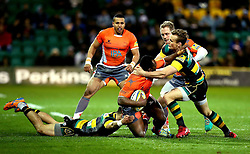 Vereniki Goneva of Newcastle Falcons is tackled by Rory Hutchinson of Northampton Saints and Tom Collins of Northampton Saints - Mandatory by-line: Robbie Stephenson/JMP - 25/11/2016 - RUGBY - Franklin's Gardens - Northampton, England - Northampton Saints v Newcastle Falcons - Aviva Premiership