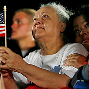 "Iris Salig, 65 and daughter Katherine Girardi journeyed from their home in Deltona at 8 AM to get a good seat for the 11 PM rally in Kissimmee.  ""Seeing President Bill Clinton hand off the torch to Barack Obama was very very moving.""  Girardi said.  The two women reflected on the drive home about the event.  ""Mom, would you do it all over again?"" Girardi asked.  ""In a heart beat."" answered Salig."