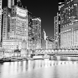 Chicago cityscape at night at Michigan Avenue DuSable Bridge along the Chicago River with 333 North Michigan Avenue building, Crain Communications building (London Guarantee), Leo Burnett building, United Airlines building, Marina City Towers, and Trump International Hotel and Tower.