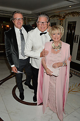 Left to right, PAUL KEATING, STEHEN WAY and GLORIA HUNNIFORD at the annual PINKTOBER Gala presented by Hard Rock Heals at The Dorchester, Park Lane, London on 14th October 2016.  The annual event raises money for The Caron Keating Foundation.