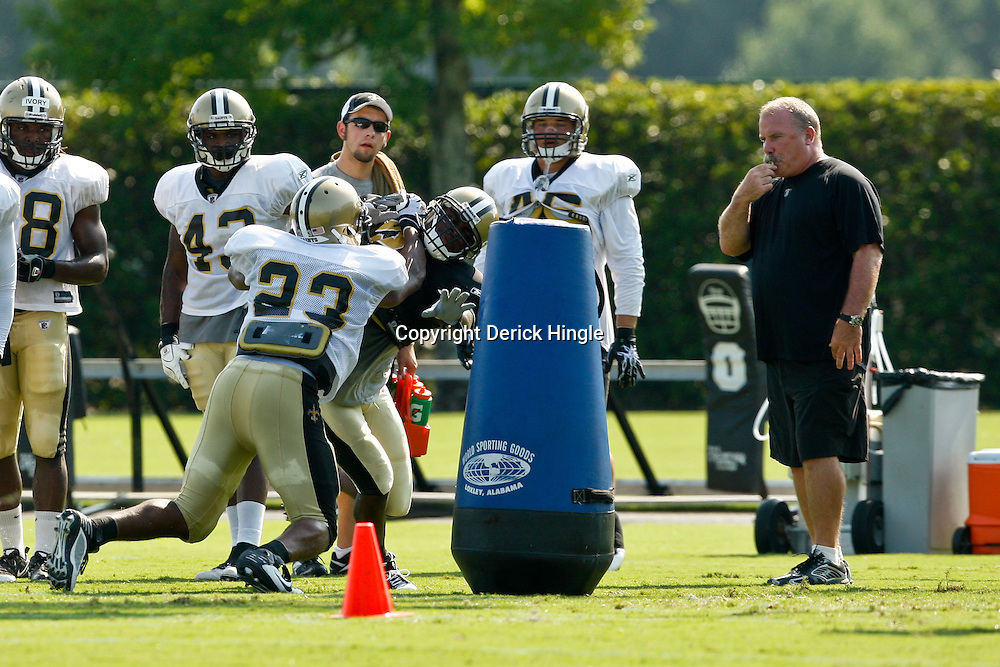 August 2, 2010; Metairie, LA, USA; New Orleans Saints running back Pierre Thomas (23) blocks linebacker Jo-Lonn Dunbar (56) in pass blocking drills during a training camp practice at the New Orleans Saints practice facility. Mandatory Credit: Derick E. Hingle