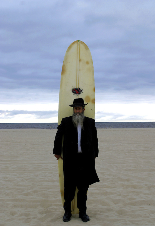 Rabbi Nachum Shifren 54 know as the Surfing Rabbi .Born in L.A  in a Jewish family but was not a religion person he start to surf wean he was 12 years old and never stop he say surfing it like a disease that get in to you and never leave you.. In 1987 Nachum start to keep the Jewish tradition and get in to the Kabala..He become to be known as the surfing rabbi,.He never stops surfing and got his on unik way to combine between Judaism and surfing...Know Nachom teaching surfing and kabala and start to organized courses all around the world..Nachom living know in L.A in Venice beach and surfing in Malibu beach, he also have a hose in the settlement named Tpuach at the west bank in Israel..Own of his rabbi that Nachom follow is the fundamentalist Rabbi Kahana (that was murder in NY by a Palestinian and create the Jewish organization the J.D.L in the U.S.A)..Nachom combine it in his on special way of getting to know god throw the sea and the secret in the kabala..
