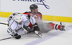 May 30; Newark, NJ, USA; Los Angeles Kings center Jarret Stoll (28) hits New Jersey Devils center Ryan Carter (20) during the second period of 2012 Stanley Cup Finals Game 1 at the Prudential Center.  The Kings defeated the Devils 2-1.