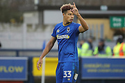 AFC Wimbledon striker Lyle Taylor (33) celebrating after scoring penalty to make it 3-1 during the The FA Cup match between AFC Wimbledon and Charlton Athletic at the Cherry Red Records Stadium, Kingston, England on 3 December 2017. Photo by Matthew Redman.