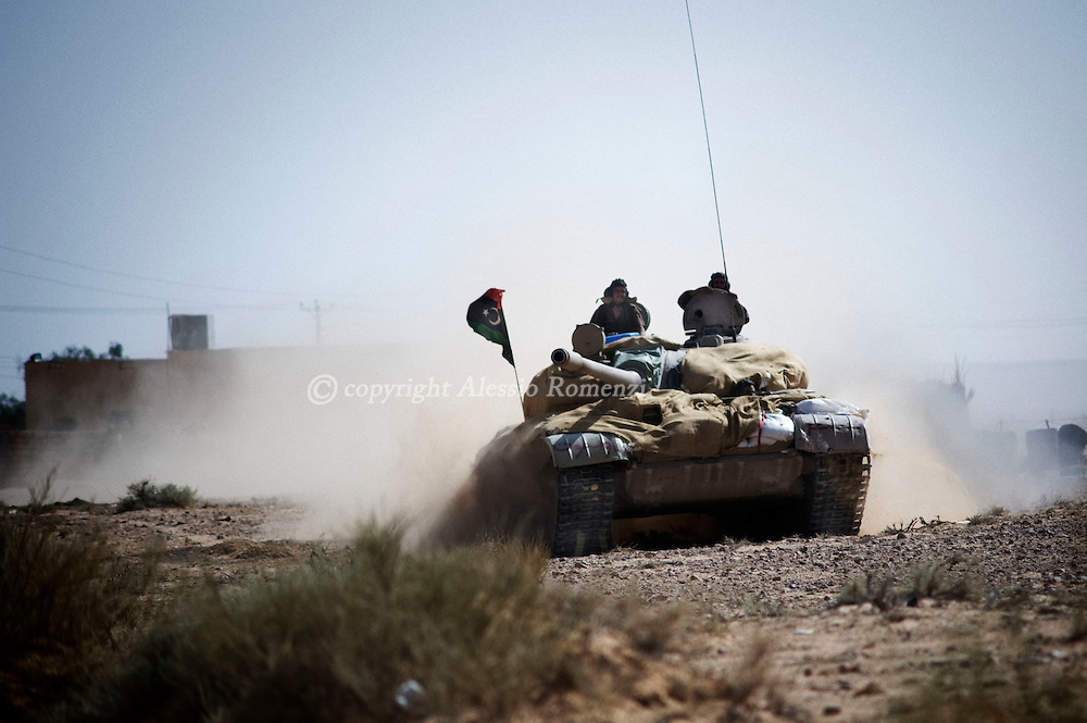 LIBYAN ARAB JAMAHIRIYA, Um al Far : A rebel tank moves through Um al Far after heavy fighting to take control of the village, on July 28, 2011. ALESSIO ROMENZI