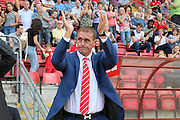 Leyton Orient Manager, Ian Hendon applauds the home fans during the Sky Bet League 2 match between Leyton Orient and Barnet at the Matchroom Stadium, London, England on 8 August 2015. Photo by Bennett Dean.