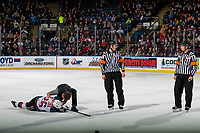 KELOWNA, CANADA - JANUARY 26: Liam Kindree #26 of the Kelowna Rockets is examined by athletic therapist Scott Hoyer on the ice after colliding with a player against the Vancouver Giants on January 26, 2019 at Prospera Place in Kelowna, British Columbia, Canada.  (Photo by Marissa Baecker/Shoot the Breeze)