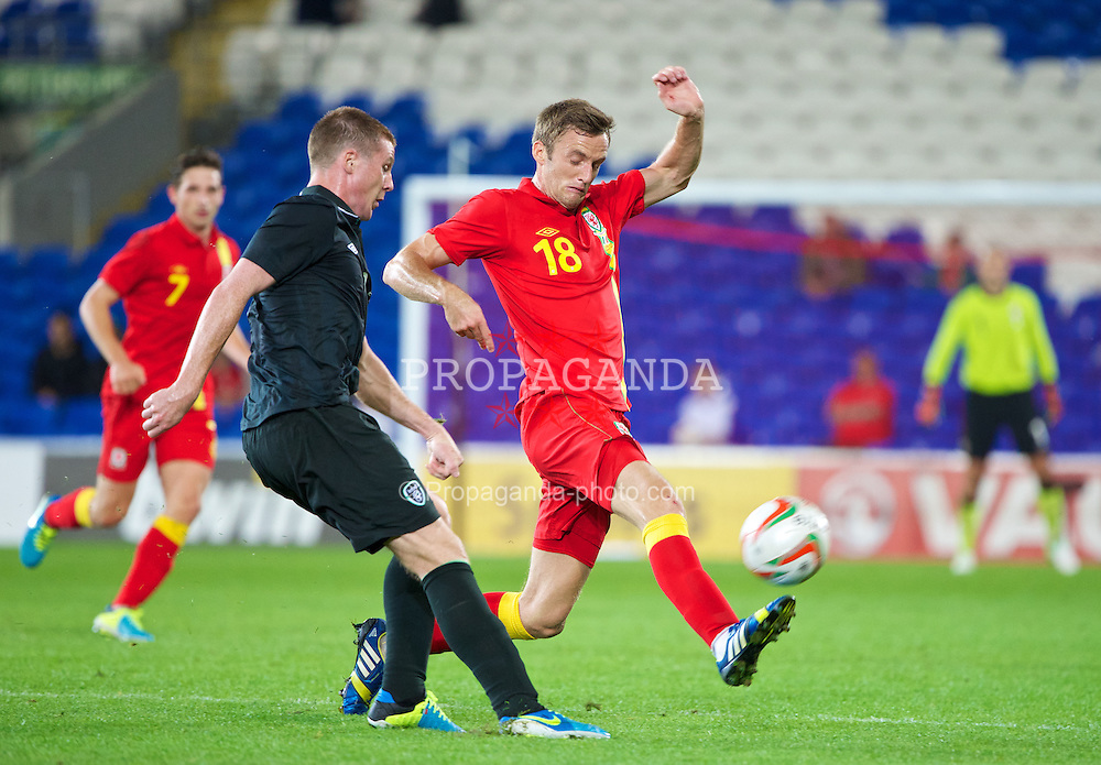 CARDIFF, WALES - Wednesday, August 14, 2013: Wales' Andy King in action against Republic of Ireland during an International Friendly at the Cardiff City Stadium. (Pic by David Rawcliffe/Propaganda)