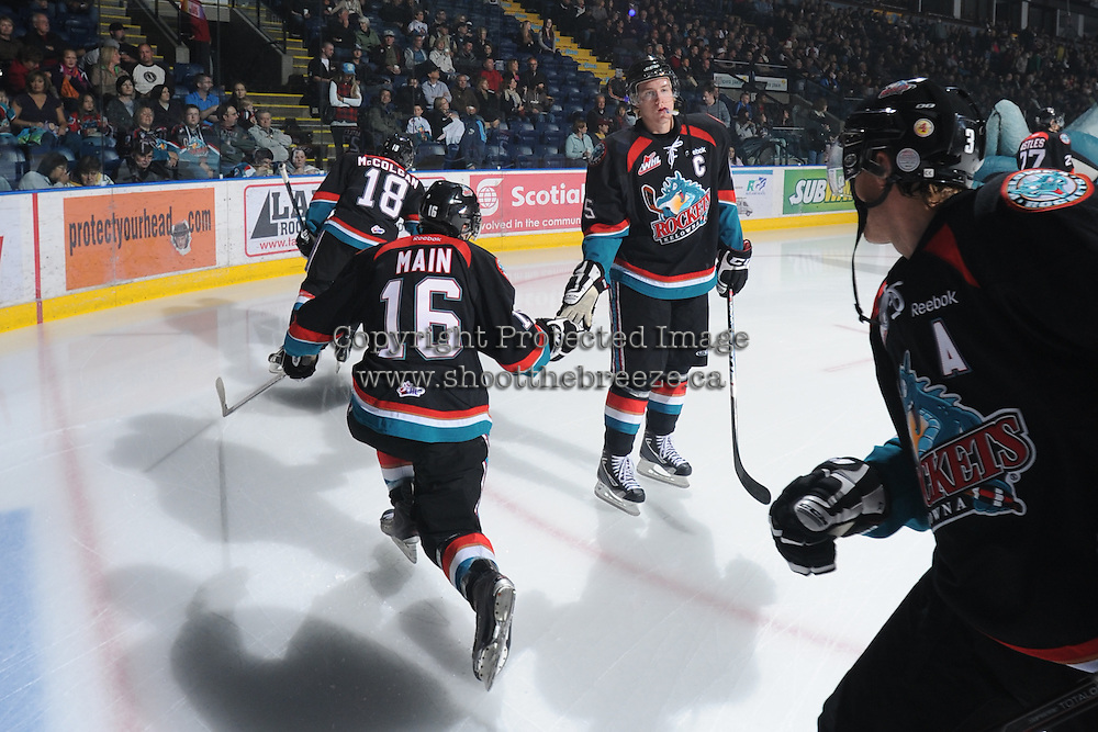 KELOWNA, CANADA, OCTOBER 5: Spencer Main #16 and Colton Sissons #15 of the Kelowna Rockets take part in a pre-game ritual against the Tri City Americans on October 5, 2011 at Prospera Place in Kelowna, British Columbia, Canada (Photo by Marissa Baecker/shootthebreeze.ca) *** Local Caption ***Spencer Main;Colton Sissons;