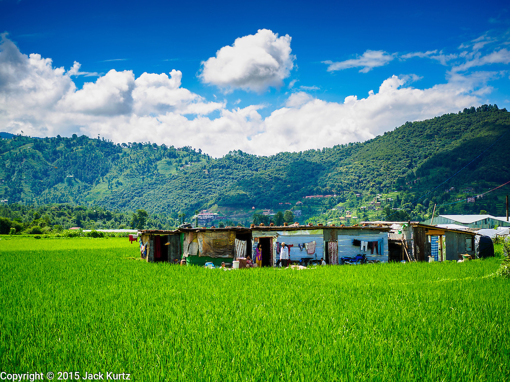 03 AUGUST 2015 - SANKHU, NEPAL:   Farmers live in temporary shelters in their rice fields in Sankhu, a community about 90 minutes from central Kathmandu. Their homes were destroyed in the earthquake. The Nepal Earthquake on April 25, 2015, (also known as the Gorkha earthquake) killed more than 9,000 people and injured more than 23,000. It had a magnitude of 7.8. The epicenter was east of the district of Lamjung, and its hypocenter was at a depth of approximately 15km (9.3mi). It was the worst natural disaster to strike Nepal since the 1934 Nepal–Bihar earthquake. The earthquake triggered an avalanche on Mount Everest, killing at least 19. The earthquake also set off an avalanche in the Langtang valley, where 250 people were reported missing. Hundreds of thousands of people were made homeless with entire villages flattened across many districts of the country. Centuries-old buildings were destroyed at UNESCO World Heritage sites in the Kathmandu Valley, including some at the Kathmandu Durbar Square, the Patan Durbar Squar, the Bhaktapur Durbar Square, the Changu Narayan Temple and the Swayambhunath Stupa. Geophysicists and other experts had warned for decades that Nepal was vulnerable to a deadly earthquake, particularly because of its geology, urbanization, and architecture.    PHOTO BY JACK KURTZ