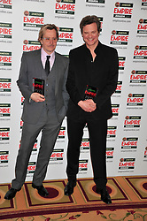 © under license to London News Pictures. 27/03/11. Gary Oldman and Colin Firth on the Winners Boards at the Jamesons Empire Film Awards, 27th March 2011 at the Grosvenor House Hotel, London. Colin Firth won Best Actor and presented the Empire Icon prize to Gary Oldman. Photo credit should read Alan Roxborough/LNP