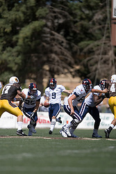 Virginia kicker Chris Gould (9) punts against Wyoming.  The Wyoming Cowboys defeated the Virginia Cavaliers 23-3 at War Memorial Stadium in Laramie, WY on September 1, 2007.