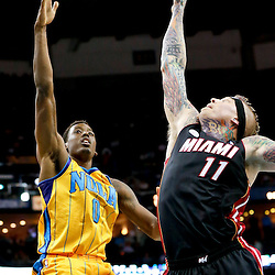 Mar 29, 2013; New Orleans, LA, USA; New Orleans Hornets small forward Al-Farouq Aminu (0) shoots over Miami Heat power forward Chris Andersen (11) during the second quarter of a game at the New Orleans Arena. Mandatory Credit: Derick E. Hingle-USA TODAY Sports