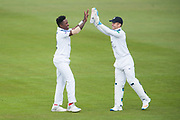 Fidel Edwards and Lewis McManus of Hampshire celebrate during the Specsavers County Champ Div 1 match between Hampshire County Cricket Club and Middlesex County Cricket Club at the Ageas Bowl, Southampton, United Kingdom on 14 April 2017. Photo by David Vokes.