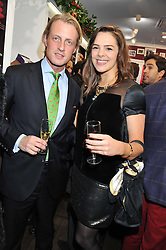 FRANS VON CHRISMAR and NINA FROST at the launch party for the Vicomte A boutique in London at 113 King's Road, London SW3 on 13th December 2012.