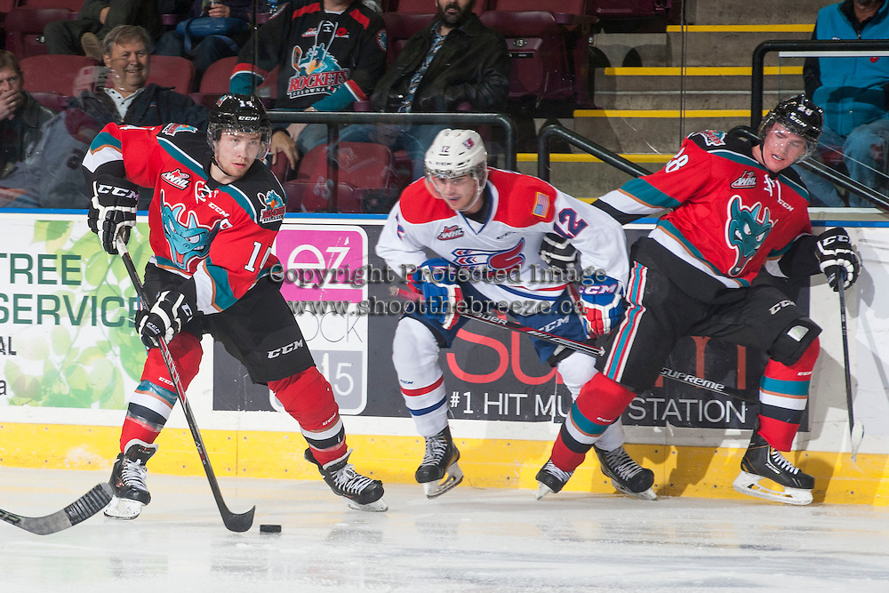 KELOWNA, CANADA - NOVEMBER 7: Rourke Chartier #14 of Kelowna Rockets handles the puck against the Spokane Chiefs on November 7, 2014 at Prospera Place in Kelowna, British Columbia, Canada.  (Photo by Marissa Baecker/Shoot the Breeze)  *** Local Caption *** Rourke Chartier;