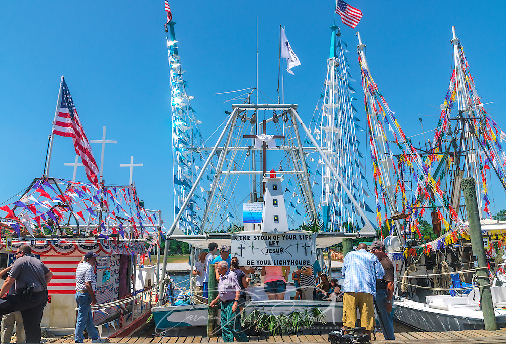 """David's Pride"" is docked with other decorated boats during the 65th annual Blessing of the Fleet in Bayou La Batre, Alabama, May 4, 2014.  The vessel took first place among the decorated, large commercial boats. The first fleet blessing was held by St. Margaret's Catholic Church in 1949, carrying on a long European tradition of asking God's favor for a bountiful seafood harvest and protection from the perils of the sea. The highlight of the event is a blessing of the boats by the local Catholic archbishop and the tossing of a ceremonial wreath in memory of those who have lost their lives at sea. The event also includes a land parade and a parade of decorated boats that slowly cruise through the bayou. (Photo by Carmen K. Sisson/Cloudybright)"