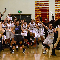 La Canada's Kristina Kurdoghlian (11) jumps for joy after hitting the game winning shot to defeat Corona Del Mar 55-52 during a semifinal prep basketball game at La Canada High School in La Canada, Calif., on Saturday, Feb. 27, 2016.