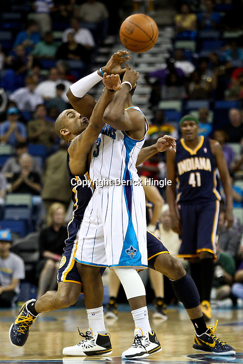April 3, 2011; New Orleans, LA, USA; Indiana Pacers shooting guard Dahntay Jones (1) knocks away and steals the ball from New Orleans Hornets point guard Chris Paul (3) during the fourth quarter at the New Orleans Arena. The Hornets defeated the Pacers 108-96.  Mandatory Credit: Derick E. Hingle