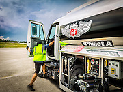 A Phillips 66 Aviation Fuels lineman mounts his vehicle at Opa-locka Executive Airport, near Miami.  Created as an advertising image.
