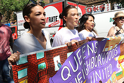 June 30, 2018 - New York City, New York, US - Alexandria Ocasio-Cortez, left,  democratic primary winner who defeated powerful US Congressman Joe Crowley (D-NY)  in the New York democratic primary on 26th. June, 2018 was a crowd favorite at the #FamiliesBelongTogether rally and march. The End Family Separation NYC Rally and March is one of several similar #FamiliesBelongTogether protest events taking place across the U.S. this weekend, 30th. June, 2018. This Queens, New York march and rally, took place in the most ethnically diverse neighborhood  of the city in Jackson Heights and drew hundreds of passionate activist and protesters. (Credit Image: © G. Ronald Lopez via ZUMA Wire)