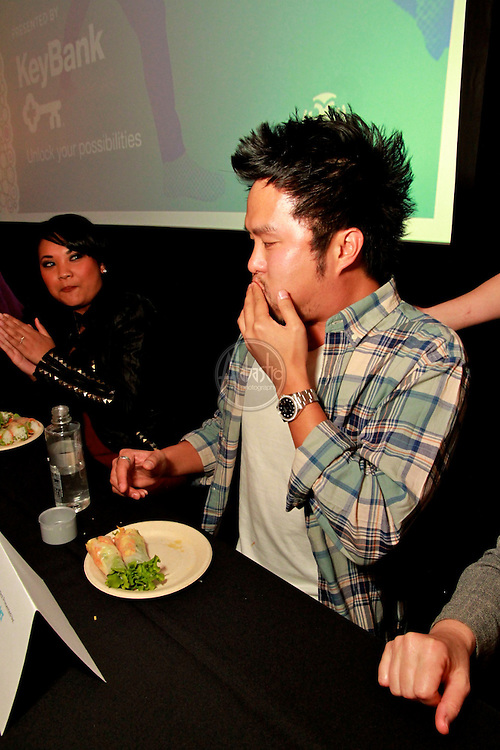 """Celebrity Spring Roll Eating Contest at ID Spring Roll 2010 """"Party Down for Chinatown"""". Winner: Seattle Seahawk Safety Lawyer Milloy. Trophy created by Christina Seong."""