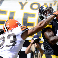 Pittsburgh Steelers wide receiver Antonio Brown (84) pulls in a 35 yard pass for a touchdown with Cleveland Browns cornerback Joe Haden (23) in coverage in the second quarter at Heinz Field in Pittsburgh on September 7, 2014.  UPI/Archie Carpenter