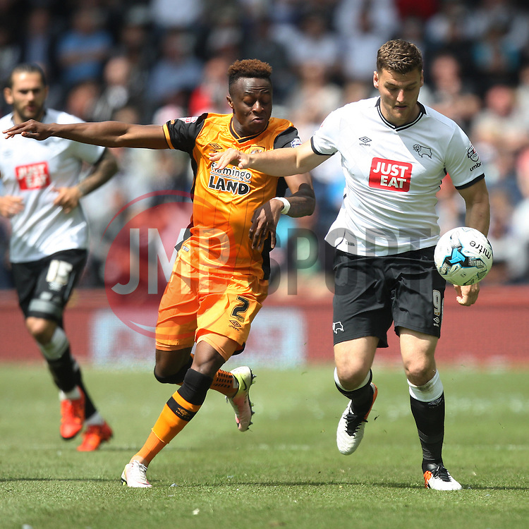 Moses Odubajo of Hull City (L) and Chris Martin of Derby County in action - Mandatory by-line: Jack Phillips/JMP - 14/05/2016 - FOOTBALL - iPro Stadium - Derby, England - Derby County v Hull City - Sky Bet Championship Play-Off Semi-Final First-Leg