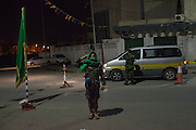 Volunteers from Pro Khaddafi Militia People's comitees guard Roads during the night establishing check points in order to control the acces to neighborhoods.