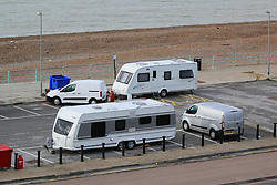 © Licensed to London News Pictures. 25/10/2014. Brighton, UK. A group of travellers with 18 caravans and extra vehicles that moved on to a public space on Black Rock near Brighton Marina have been issued with a Claim Form for Possession of Property on October 17th 2014 with a hearing scheduled for October 24th 2014. The Brighton and Hove Council's website states an eviction would be carried out as soon as practicable should the families fail to leave the site voluntarily. Photo credit : Hugo Michiels/LNP