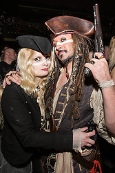 © Licensed to London News Pictures . 01/04/2014 . Manchester , UK . Fans Morganna Bramah (33 from Manchester) and Wayne Truman (39 from Derbyshire) in the audience . Adam Ant performs at the Manchester Ritz this evening (Tuesday 1st April 2014) . Photo credit : Joel Goodman/LNP
