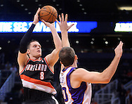 Oct. 12, 2012; Phoenix, AZ, USA; Portland Trail Blazers forward Luke Babbitt (8) puts up a shot against the Phoenix Suns forward Luke Zeller (40)during the first half at US Airways Center. Mandatory Credit: Jennifer Stewart-US PRESSWIRE.