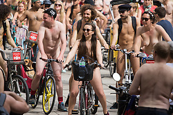 Westminster Bridge, London, June 11th 2016. Hundreds of naked and semi-naked cyclists participate in the World Naked Bike Ride that takes place in cities around the world, to highlight the alternatives to hydrocarbon fuels. PICTURED: Cyclists move off after a break to allow stragglers to catch up.