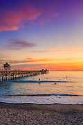 Surfers at the San Clemente Pier at Sunset