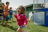 """Lucia was excited the """"dunk"""" Michael Giovanitto in the Cal Ripken dunking booth during Old Home Day festivities on Saturday afternoon.  (Karen Bobotas/for the Laconia Daily Sun)"""