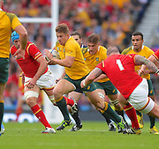 Drew  Mitchell finds a gap during the Rugby World Cup Pool A match between Australia and Wales at Twickenham, Richmond, United Kingdom on 10 October 2015. Photo by Ian Muir.during the Rugby World Cup Pool A match between Australia and Wales at Twickenham, Richmond, United Kingdom on 10 October 2015. Photo by Ian Muir.